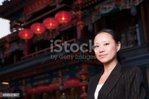 519052198 istock photo Portrait of businesswomen with Chinese architecture in background. 459502907