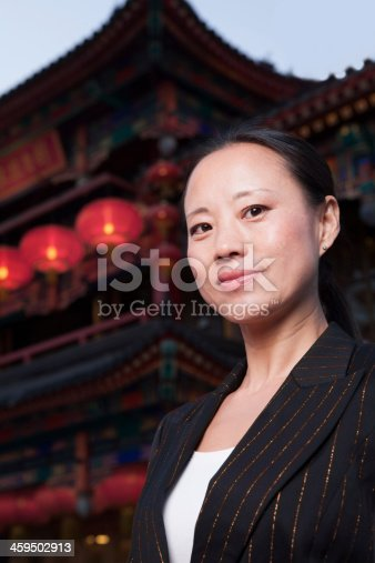 519052198 istock photo Portrait of businesswomen with Chinese architecture in background. 459502913