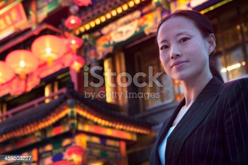 519052198 istock photo Portrait of businesswomen with Chinese architecture in background. 459503227