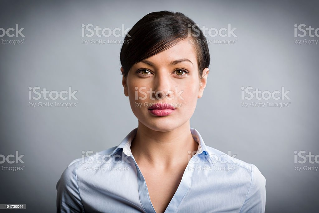 Portrait of candid pretty businesswoman with authentic look. stock photo