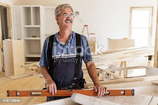 594910248istockphoto Portrait of Carpenter 476715846