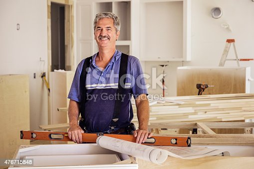 594910248istockphoto Portrait of Carpenter 476715848