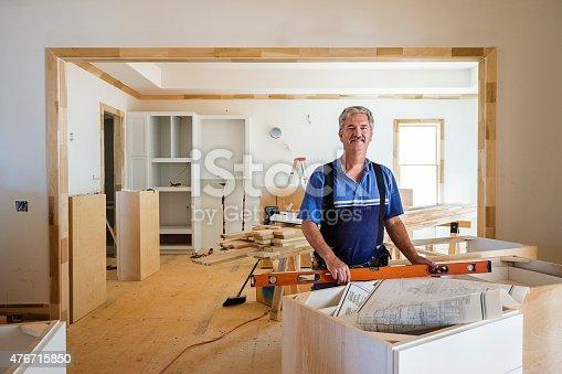 594910248istockphoto Portrait of Carpenter 476715850