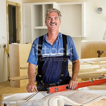 594910248istockphoto Portrait of Carpenter 476715856