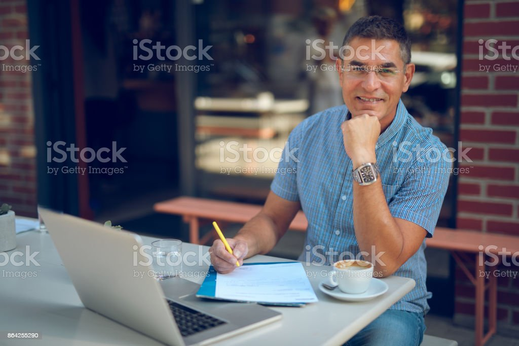 Portrait of casual mature businessman working in cafe royalty-free stock photo
