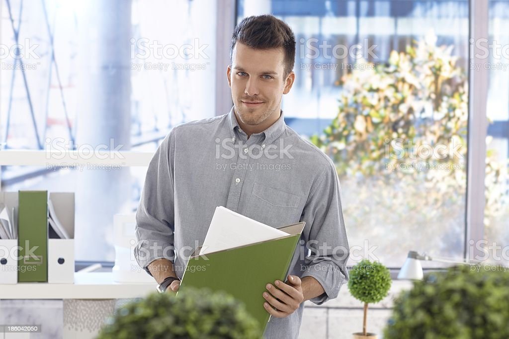 Portrait of casual office worker with folder royalty-free stock photo