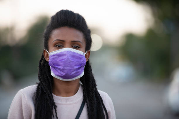 Portrait of casual woman wearing a face mask, protecting herself from coronavirus. stock photo