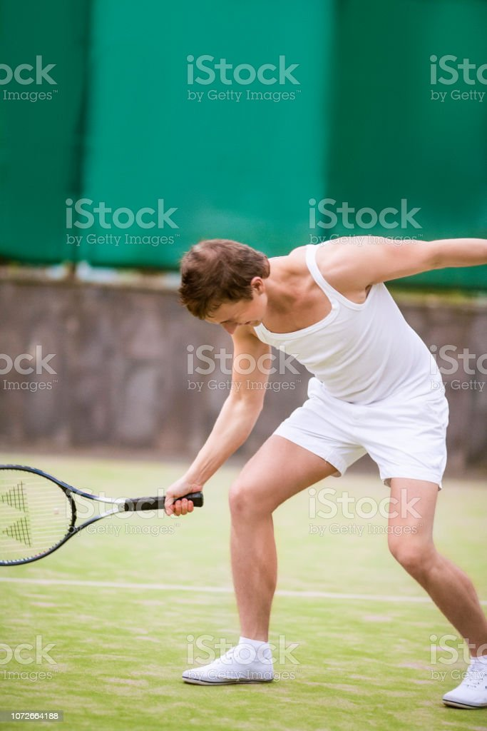 Portrait Of Caucasian Handsome Man In Tennis Outfit Posing With Tennis Racquet Outside Stock Photo Download Image Now Istock