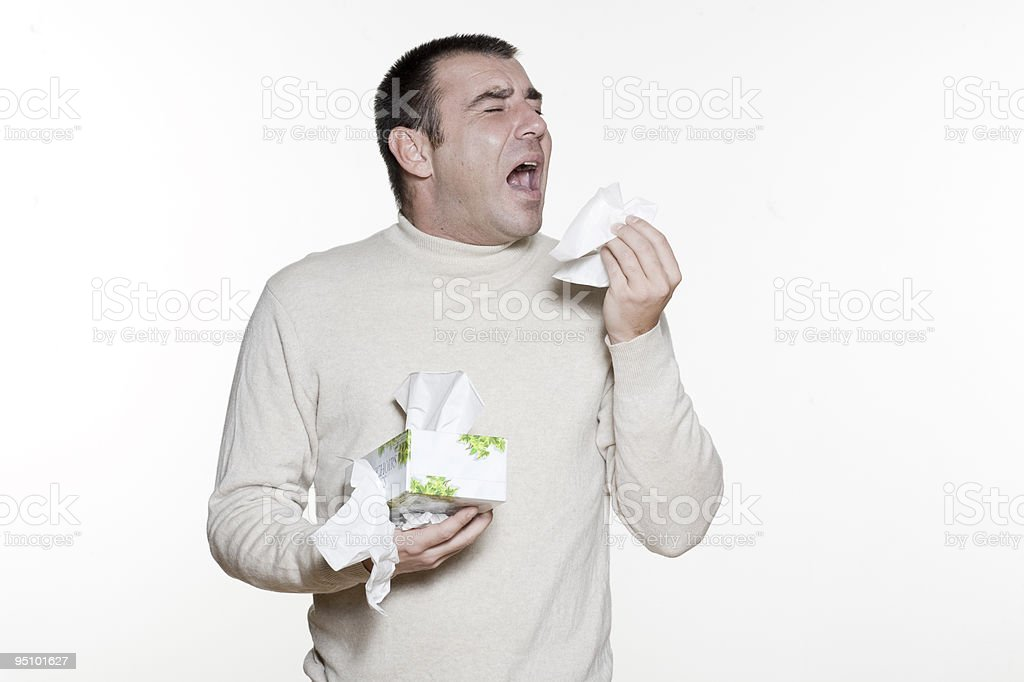 Portrait of caucasian man sneezing stock photo