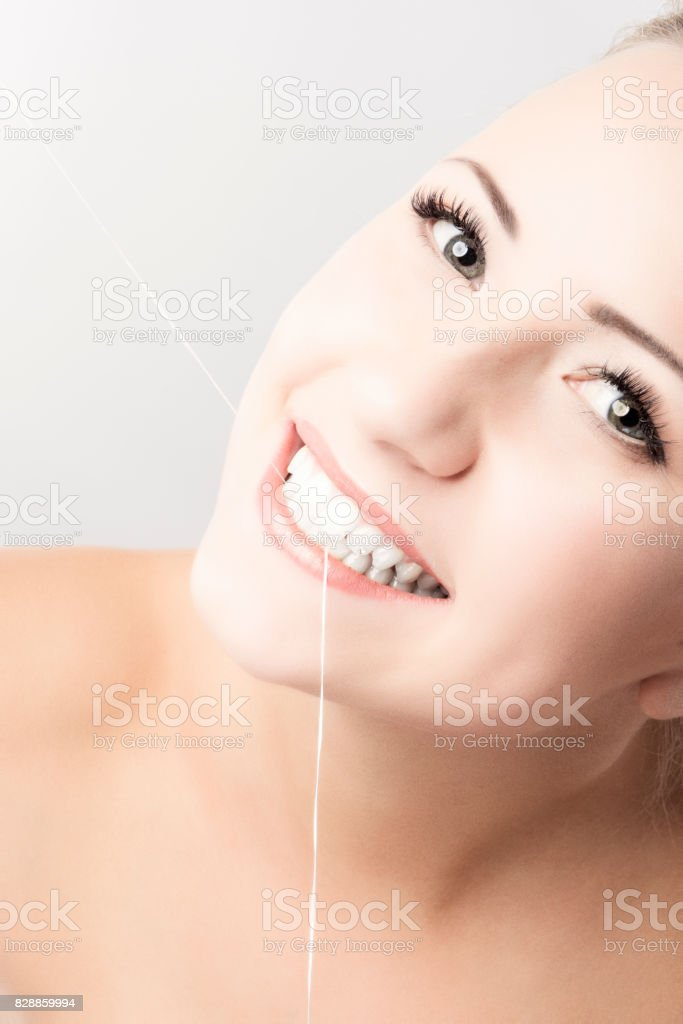 Portrait of Caucasian Woman Holding Dental Floss. stock photo