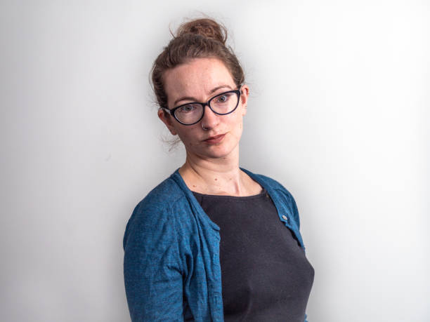 Portrait of caucasian woman wearing glasses and blue sweater stock photo
