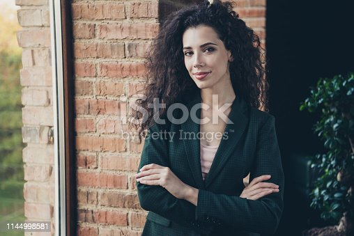 Portrait of charming attractive elegant expert entrepreneur trendy stylish feel satisfied relaxed content glad  ready success dressed modern fashionable clothing classic stand window in industrial