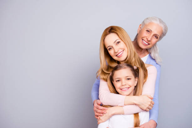 portrait of charming beautiful friendly king supportive cute family members hugging each other isolated on gray background copyspace - daughter stock photos and pictures
