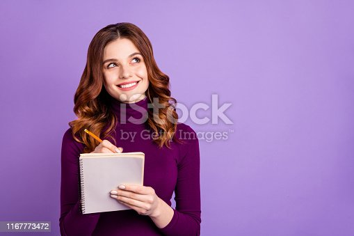 istock Portrait of charming college people holding hand pencil having thoughts isolated over purple violet background 1167773472