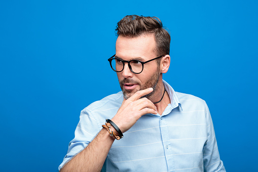 Portrait Of Charming Handsome Man Blue Background Stock Photo - Download Image Now