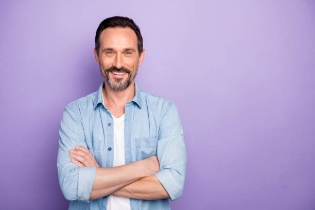Portrait of charming man cross hands look good like real start-up expert wear stylish clothing isolated over violet color background stock photo