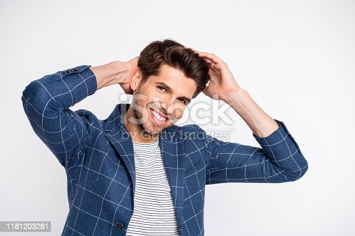 Portrait of charming virile guy fix his haircut touch hairstyle wear blue outfit, blazer jacket isolated over white background