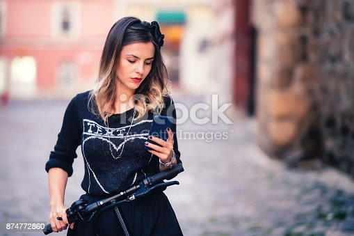 874772840istockphoto Portrait of charming woman writing text and posting on social media. Modern life details concept 874772860