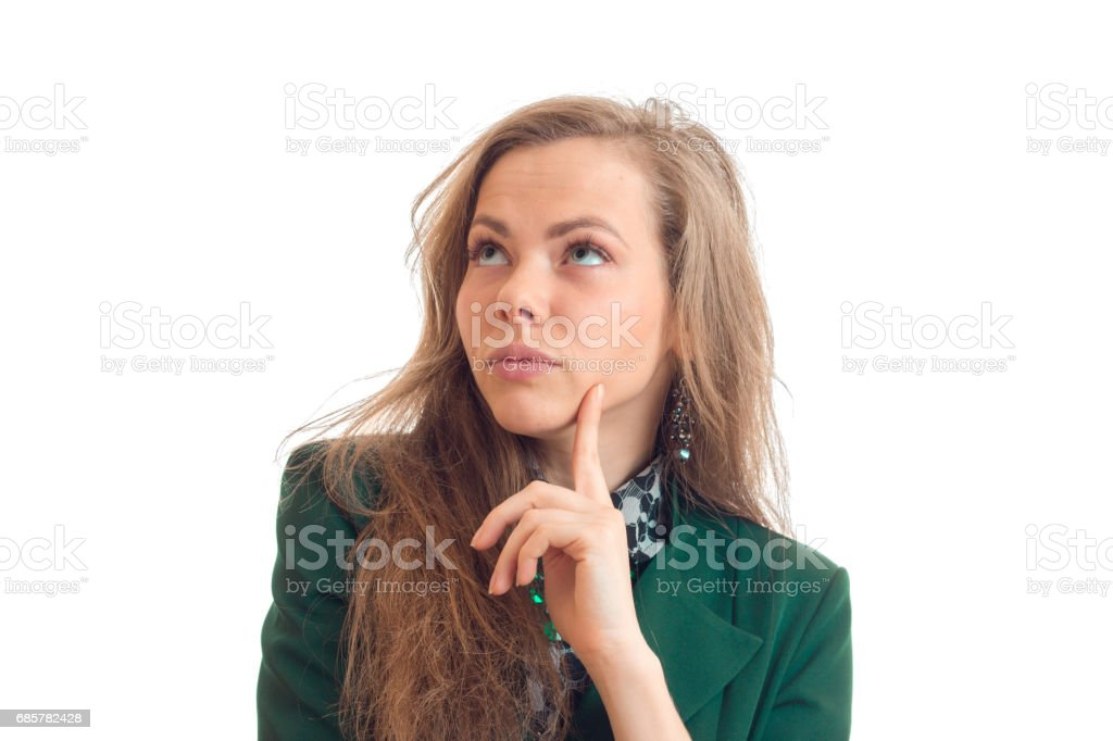 Portrait of charming young blonde who thoughtfully looking up and keeps the finger near the face royalty-free stock photo