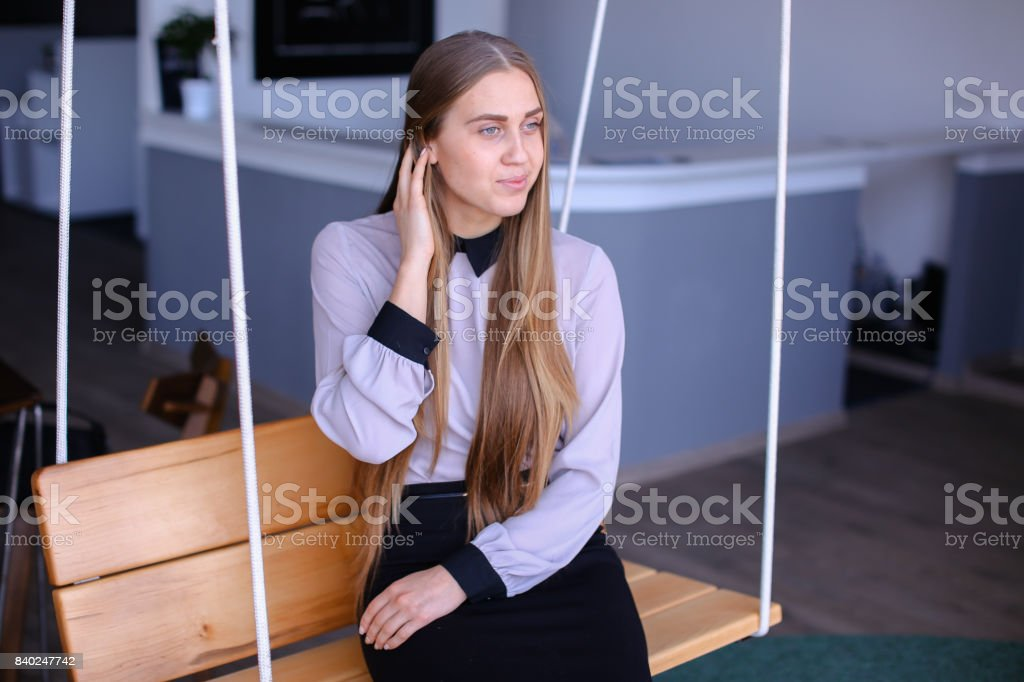 Portrait of charming young business woman looking away with smil stock photo
