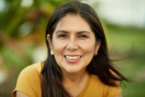 Portrait of Cheerful 50 Year Old Hispanic Woman stock photo