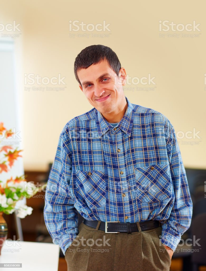 portrait of cheerful adult man with disability in rehabilitation center stock photo