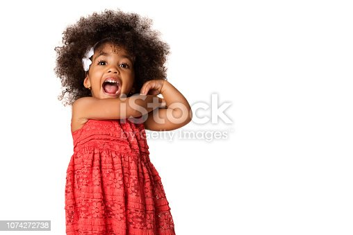 Portrait of cheerful african american little girl, isolated over white background with copyspace