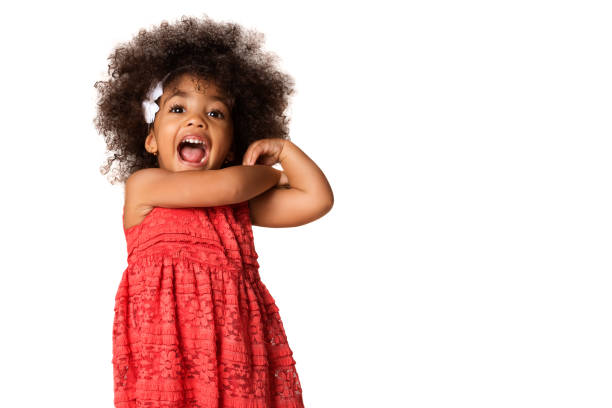 Portrait of cheerful african american little girl, isolated with copyspace Portrait of cheerful african american little girl, isolated over white background with copyspace girls stock pictures, royalty-free photos & images