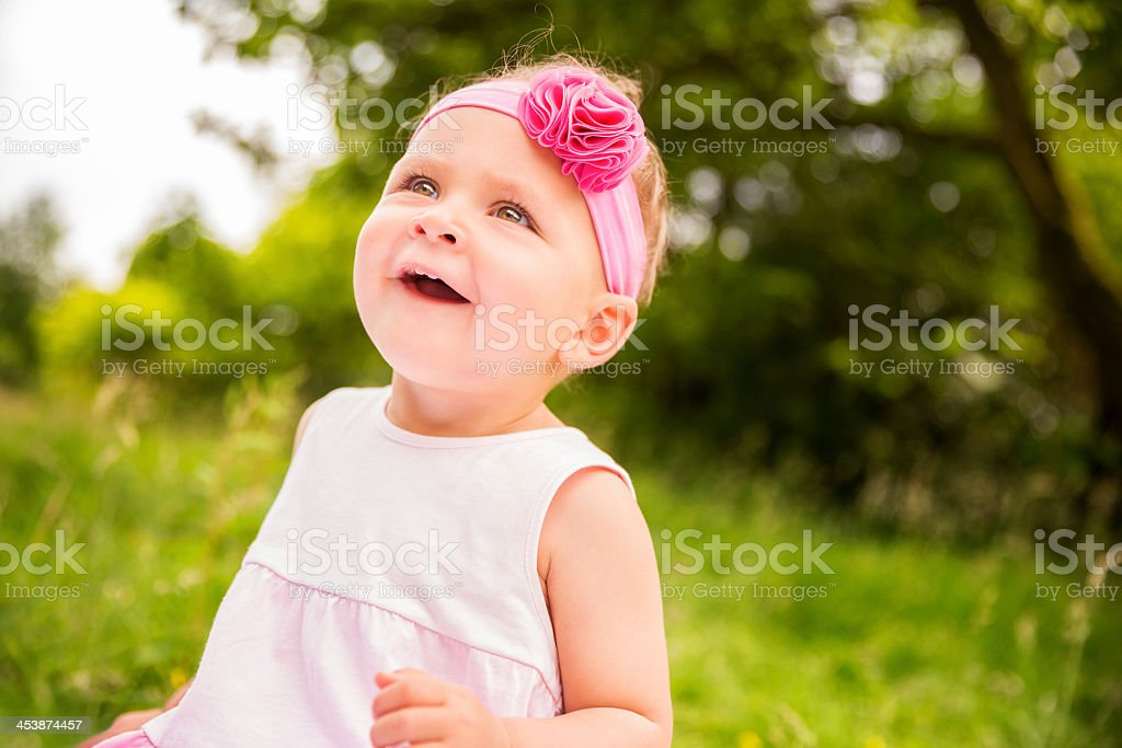Portrait of cheerful baby girl smiling in nature royalty-free stock photo