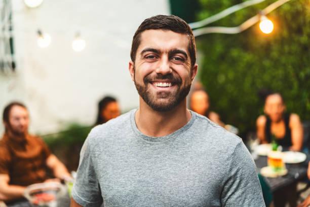 Portrait of cheerful bearded man in yard stock photo