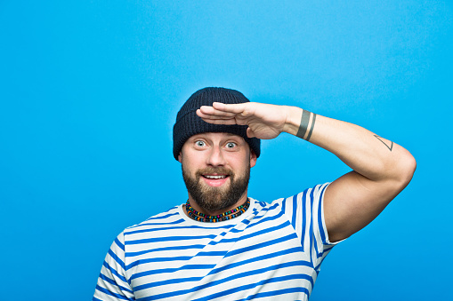 Portrait Of Cheerful Bearded Sailor Against Ble Background Stock Photo - Download Image Now