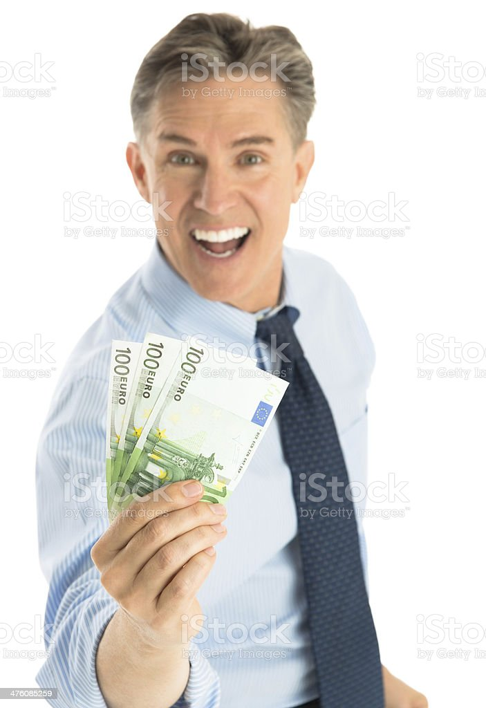 Portrait Of Cheerful Businessman Holding Euro Banknotes royalty-free stock photo