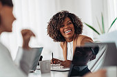 istock Portrait of cheerful businesswoman smiling at the meeting 1218610083