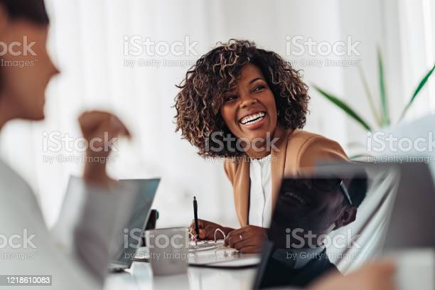 Photo of Portrait of cheerful businesswoman smiling at the meeting