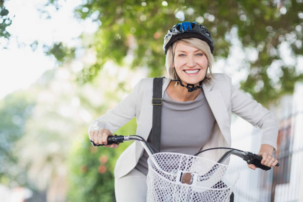Portrait of cheerful businesswoman with bicycle stock photo