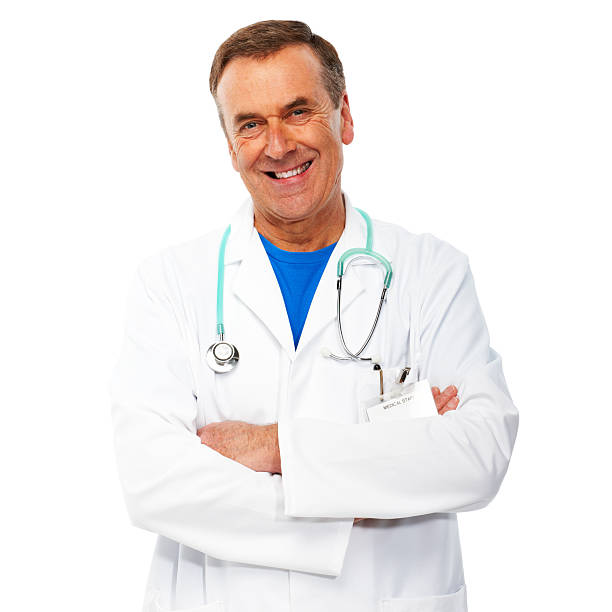 Portrait of cheerful doctor with arms folded on white background stock photo