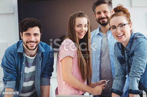 istock Portrait of cheerful editors at creative office 649457878