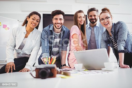 istock Portrait of cheerful editors standing at creative office 649457892