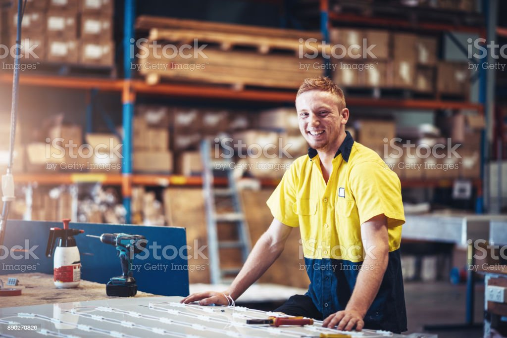 Portrait of cheerful ginger blue collar worker in factory in Australia stock photo