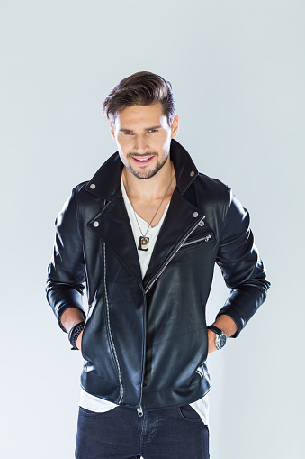 Portrait Of Cheerful Handsome Man Wearing Leather Jacket Stock Photo - Download Image Now