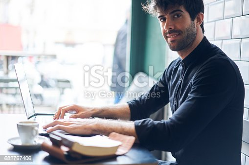istock Portrait of cheerful male journalist 682767406