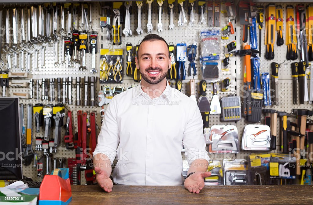 portrait of cheerful man at the cash desk working stock photo