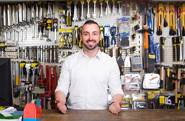 portrait of cheerful man at the cash desk working - store counter stock photos and pictures