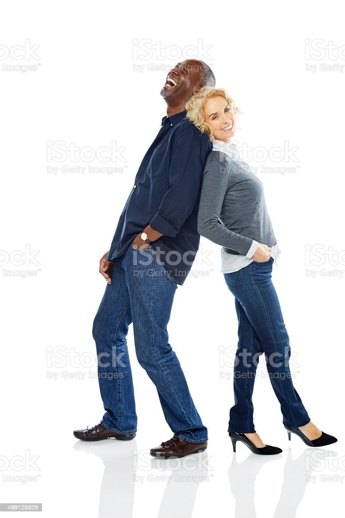 Portrait of cheerful mature couple standing on white stock photo
