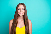 Portrait of cheerful nice sweet attractive magnificent straight-haired girl, isolated over green turquoise background