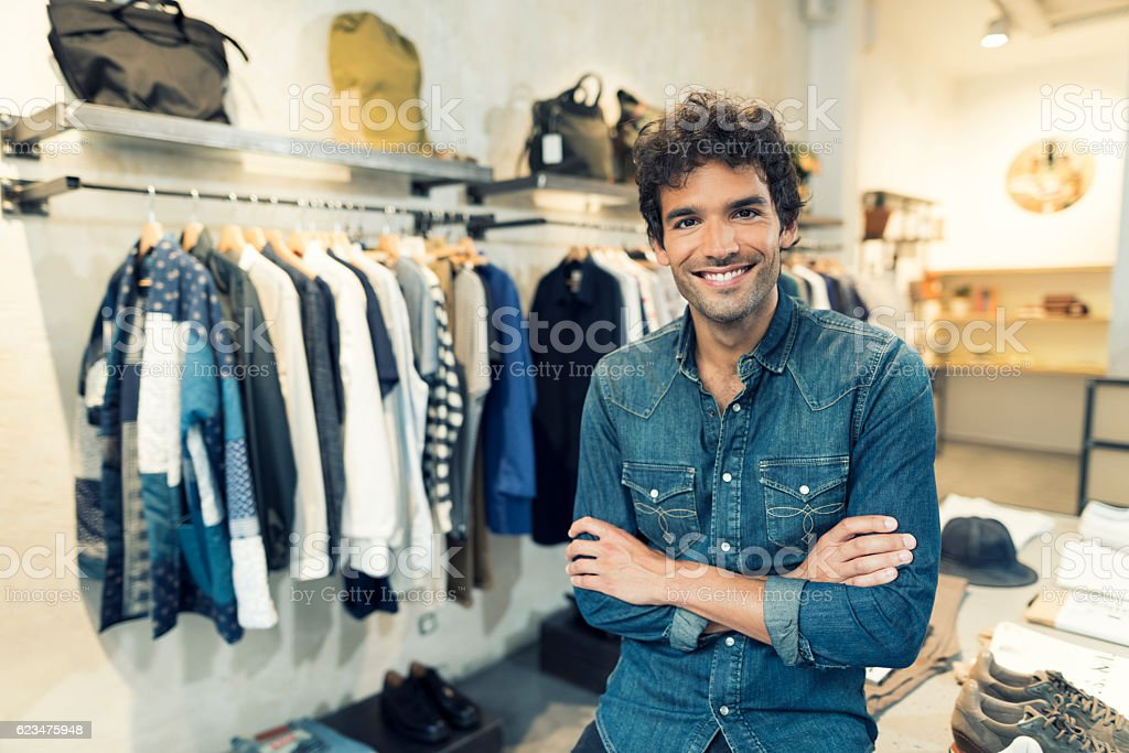 Portrait of cheerful owner in clothing store. Looking at camera bildbanksfoto