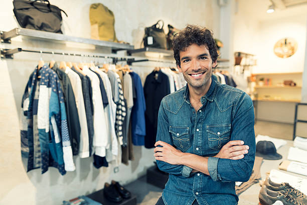 Portrait of cheerful owner in clothing store. Looking at camera stock photo