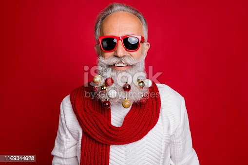 Portrait of cheerful pensioner in eyewear eyeglasses smiling wearing white sweater isolated over red background