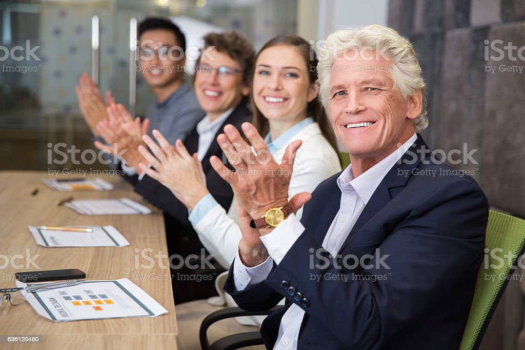 Portrait of cheerful people applauding stock photo