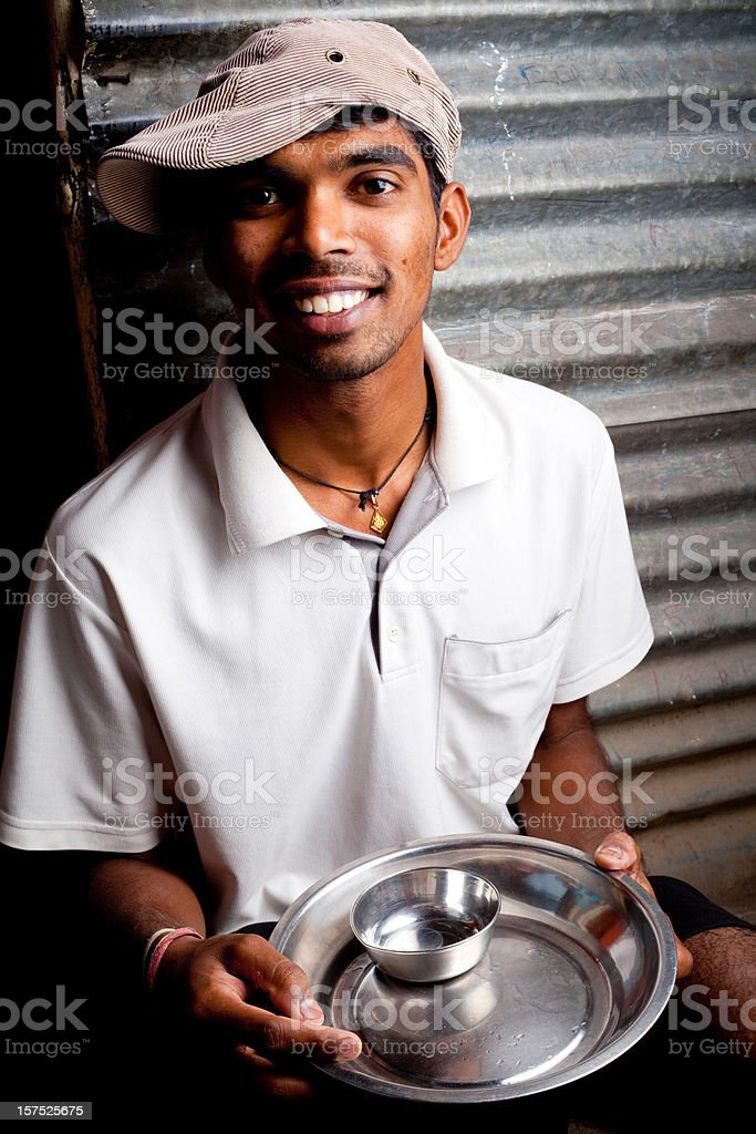 Portrait of Cheerful Rural Indian Youth with empty utensils royalty-free stock photo